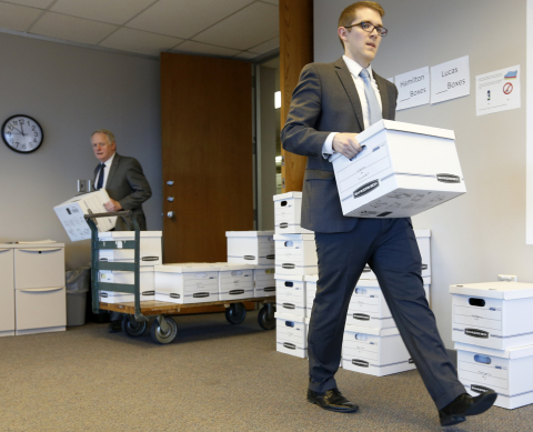 Donald J. McTigue and Derek Klinger from McTigue, McGinnis & Colombo law firm submit 171,205 voter signatures in support of the Ohio Drug Price Relief Act to the Secretary of State's office on December 22. (Photo: Business Wire)