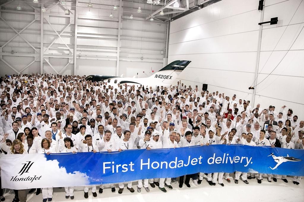 Honda Aircraft Company associates celebrate the first HondaJet delivery. (Photo: Business Wire)
