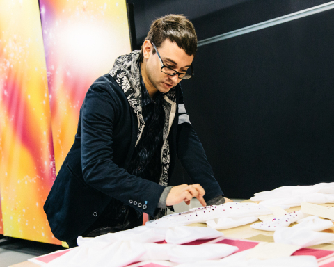 Fashion designer Christian Siriano works on his custom red carpet creation for Minnie Mouse in Glendale, CA. Photo courtesy of Disney Consumer Products