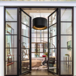 The Pella Crafted Luxury showroom artfully displays windows and doors within six style vignettes, including the Urban Loft. The steel windows and doors with black aluminum clad exteriors are a dramatic feature of the Urban Loft room. (Photo: Pella Corporation)