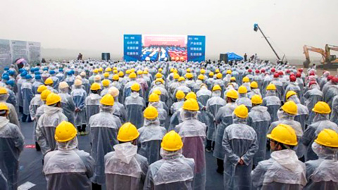 Workers Watch Ground-Breaking Ceremony for first-ever Six Flags-branded theme park in China. (Photo: ...