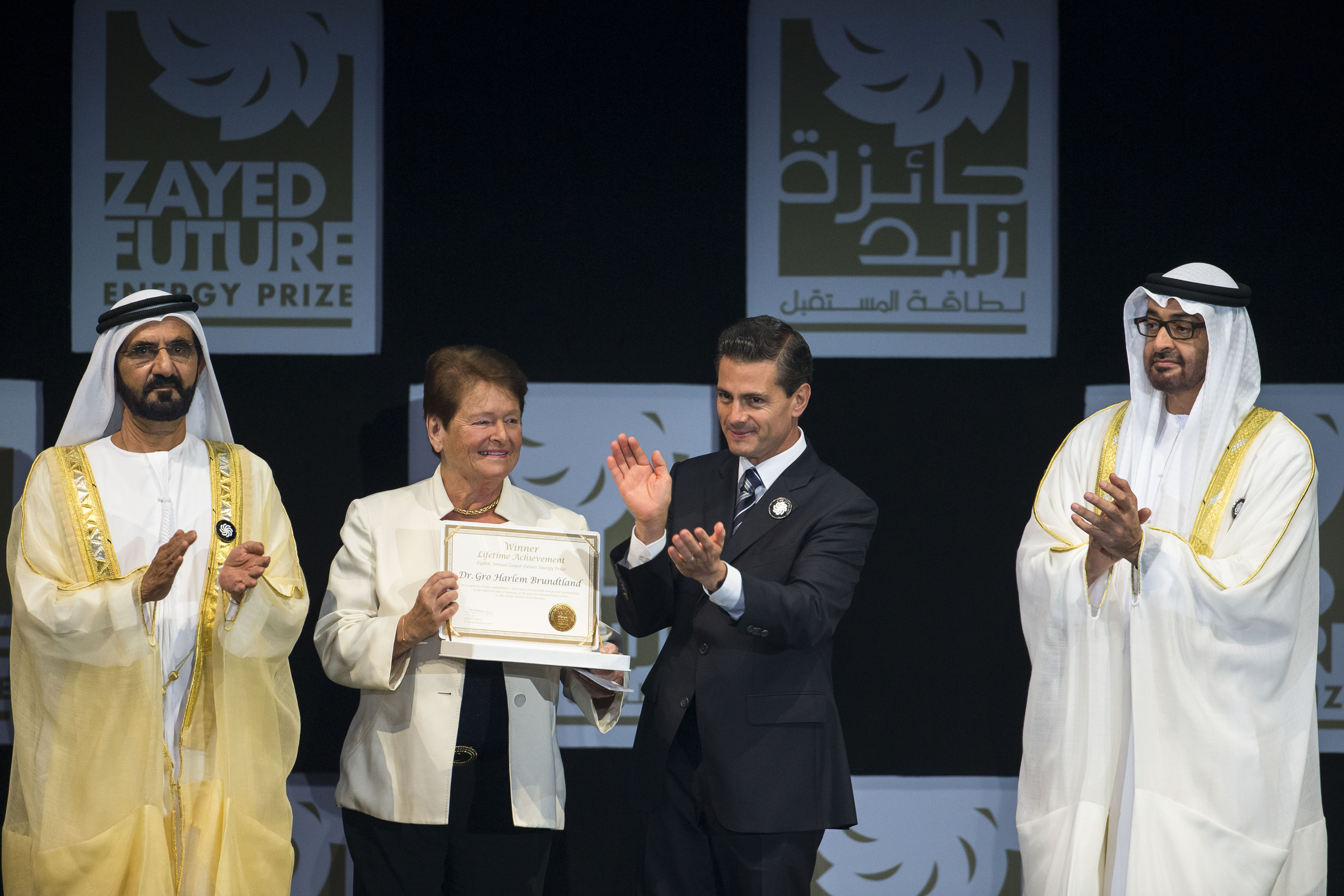HH Sheikh Mohammed bin Rashid Al Maktoum, Vice-President, Prime Minister of the UAE and Ruler of Dubai (L), HH Sheikh Mohammed bin Zayed Al Nahyan, Crown Prince of Abu Dhabi, Deputy Supreme Commander of the UAE Armed Forces (R), and HE Enrique Pena Nieto, President of Mexico (2nd R), present the Zayed Future Energy Prize Lifetime Achievement award to Dr. Gro Harlem Brundtland, former Prime Minister of Norway, current Special Envoy with the United Nations, and the Deputy Chair of The Elders (2nd L), during the opening ceremony of the World Future Energy Summit 2016, as part of Abu Dhabi Sustainability Week, at Abu Dhabi National Exhibition Centre (ADNEC). (Philip Cheung / Crown Prince Court - Abu Dhabi)(Photo: ME Newswire)