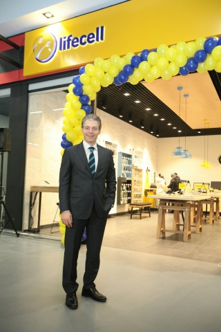 Burak Ersoy, the CEO of lifecell, in front of a recently rebranded lifecell store in Kyiv, the capit ...
