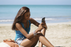 A woman using Wi-Fi service in the Caribbean (Photo: Business Wire)