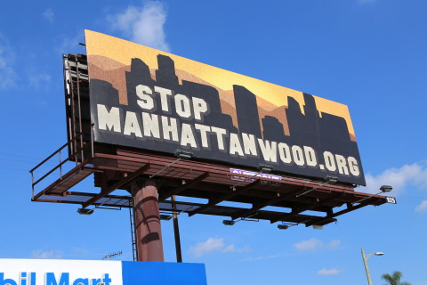 'Stop Manhattanwood,' a new advocacy and awareness billboard campaign backed by AHF that exposes the downside of overdevelopment in Los Angeles launched earlier this week. (Photo: Business Wire)