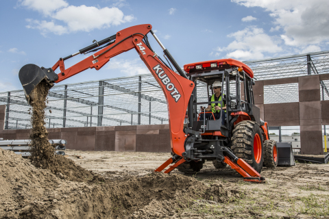 The Kubota M62's backhoe boasts a 14-foot maximum digging depth, making it an attractive option to buyers in the construction and utility sectors. (Photo: Business Wire)