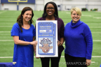 Ann D. Murtlow, President & CEO, United Way of Central Indiana (right), and Kalen Irsay, Vice Chair/Owner, The Indianapolis Colts (left), presents GEICO associate and United Way grand prize winner, Tyffani Collins (center) with two tickets to Super Bowl 50 in Santa Clara, Calif. (Photo: Business Wire)