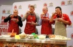 The Papa John's team celebrates the launch of its Quality Guarantee at Super Bowl 50. (Graphic: Business Wire)