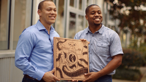 (L to R) Ross Oscar Knight poses with Atlanta based artist, Keith Rosemond II, who created original art inspired by Ross' story shared as part of Wells Fargo's #MyUntold collection. (Photo: Business Wire)