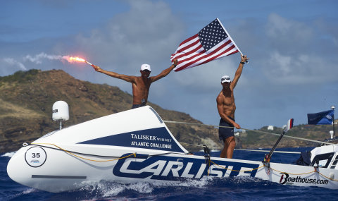 Carlisle's American Spirit and Skipper Jason Caldwell and Tom Magarov cross the finish in Antigua in America's Toughest Row (Photo: Ben Duffy Photography)