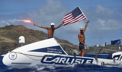 Carlisle's American Spirit and Skipper Jason Caldwell and Tom Magarov cross the finish in Antigua in America's Toughest Row (Photo: Ben Duffy Photography)