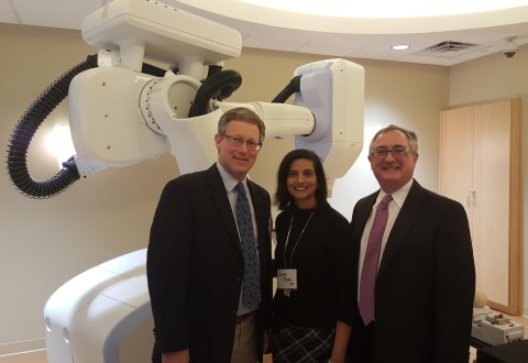 Commonwealth Health CyberKnife radiation oncologists John Lamond M.D., Suman Tawari, M.D., and Michael Lambo M.D., with the CyberKnife Robotic Radiosurgery System. (Photo: Business Wire)