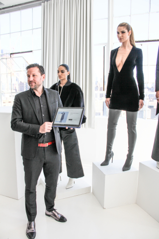 BigCommerce chief product officer Tim Schulz showcases LaQuan Smith's Martine dress available for sale online with the model wearing it during Smith's presentation at New York Fashion Week. (Photo: Business Wire)