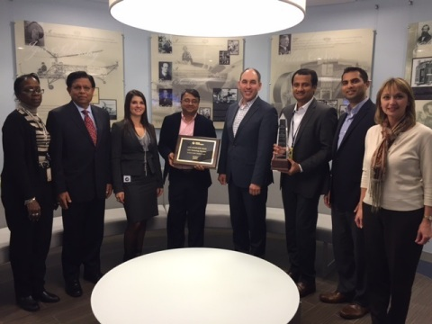 """Sanjay Barnwal, Area Vice President, USA Sales for L&T Technology Services (Centre) displays  the """"U ..."""