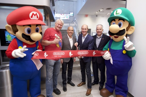 In this photo provided by Nintendo of America, Mario and Luigi unveil the remodeled Nintendo NY store during a ribbon-cutting ceremony on Feb. 19, 2016. Joining the Super Mario Bros. (left to right) are Charles Martinet, the voice of Mario, and Nintendo of America executives Doug Bowser, Vice President of Sales; Scott Moffitt, Executive Vice President of Sales & Marketing; and Rick Lessley, Vice President of the Supply Chain Group.