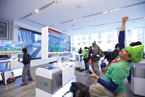 In this photo provided by Nintendo of America, Rinaldy G. of New York plays Mario Kart 8 using the Nintendo NY store's upgraded Wii U demo units at the store's reopening on Feb. 19, 2016.