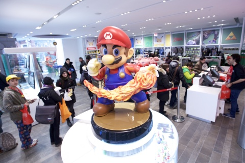 In this photo provided by Nintendo of America, guests explore the remodeled Nintendo NY store in Rockefeller Plaza at the reopening on Feb. 19, 2016.