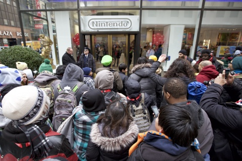 In this photo provided by Nintendo of America, Nintendo fans eagerly await the grand reopening of the remodeled Nintendo NY store in Rockefeller Plaza on Feb. 19, 2016.