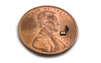 Heptagon's new module is 4x thinner than a penny - US 1 cent coin (Photo: Business Wire)