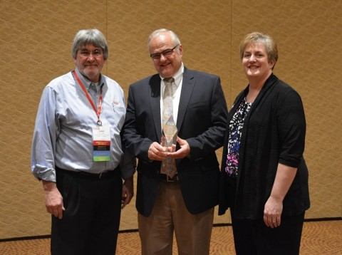 Terry Giles, ECOAT16 Steering Committee Chairman and Karne McGlothin ECOAT16 Conference Manager present Axalta's Joseph Subda with the George. E.F. Brewer Award. (Photo: Axalta)