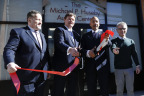Michael P. Huseby, executive chairman of Barnes & Noble Education, cuts the ribbon at the Quality Services for the Autism Community's new Michael P. Huseby Autism Center in the Bronx. He is joined by Quality Services for the Autism Community (QSAC) and Bronx city officials, including QSAC CEO Gary A. Maffei, and Bronx Borough President Ruben Diaz Jr, and New York City Council Member Jimmy Vacca. The new center will provide expanded services and facilities to the Bronx community through a Day Habilitation Program for adults with autism and a school for students with autism, set to open in September 2016. Nearly 200 children and adults with autism will be supported by the new Huseby Center. (Photo: Business Wire)