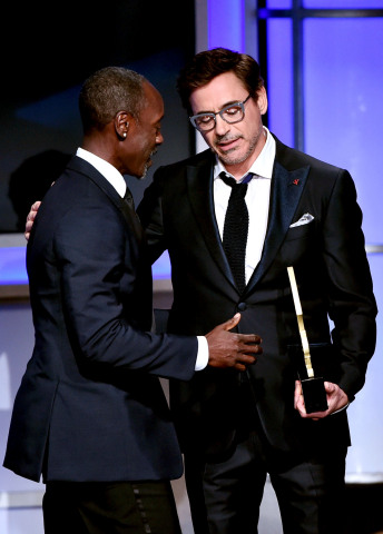 Robert Downey Jr. presents friend, Don Cheadle, with the ABFF Award for Excellence in the Arts (male) (Photo: Business Wire)