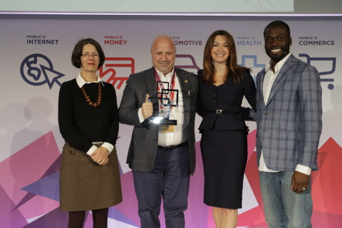 """Turkcell CEO Kaan Terzioglu receives the award for """"Best Use of Mobile for Accessibility & Inclusion"""" with """"My Dream Companion"""" during Global Mobile Awards at the Mobile World Congress in Barcelona. (Photo: Business Wire)"""