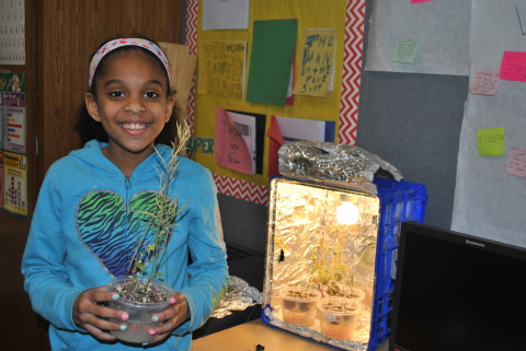 Mya Lang-Martinez, a fourth-grade student at Maplewood Elementary of the Metropolitan School District of Wayne Township, Indianapolis has the distinction of being person number 500,000 to experience Dow AgroSciences' outreach to increase enthusiasm about Science, Technology, Engineering, and Mathematics (STEM). (Photo: Business Wire)