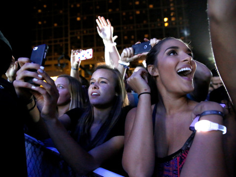 SAN DIEGO, CA - FEBRUARY 27: Jason Derulo and Hilton encourage music fans to 'Stop Clicking Around' and start playing with surprise concert outside of Hilton San Diego Bayfront on February 27, 2016 in San Diego, California. The concert celebrates the recently-launched 'Stop Clicking Around' marketing campaign and kicks off the 2016 Hilton Concert Series. Julia Cornwel (center) videos the concert. She attended with her friend Jessica Curtis. For more information, visit HHonors.com (Photo by Nancee E. Lewis/Getty Images for Hilton)