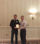 SCSPE member Jason Vaughn presenting the Young Engineer of the Year Award to Shawn Goddeyne (Photo: Business Wire)