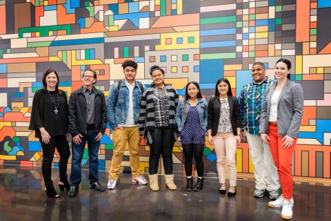 On Thursday, March 3, Dolby hosted about 60 high school juniors from the Arts, Media & Entertainment Academy at Philip & Sala Burton Academic High School, part of the San Francisco Unified School District. The students pitched their ideas for video projects to video production experts on the Dolby staff. They also toured some of the more than 100 labs and three dozen art installations in Dolby's San Francisco headquarters and heard career development tips from Dolby employees. From left to right, Jennifer Bowcock, Dolby VP of Communications; teacher Doug Singer; students Uilisone Tagaloa, Donna Fonoti, Zabrina Bustos, Lennevoir Dumdumaya, Lamar Chappelle; Simone Price, Dolby senior community relations specialist. (Photo: Business Wire)