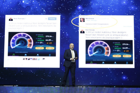 Turkcell CEO Kaan Terzioglu on stage with 4.5G speed test on screen during Turkcell's 8th annual Tec ...