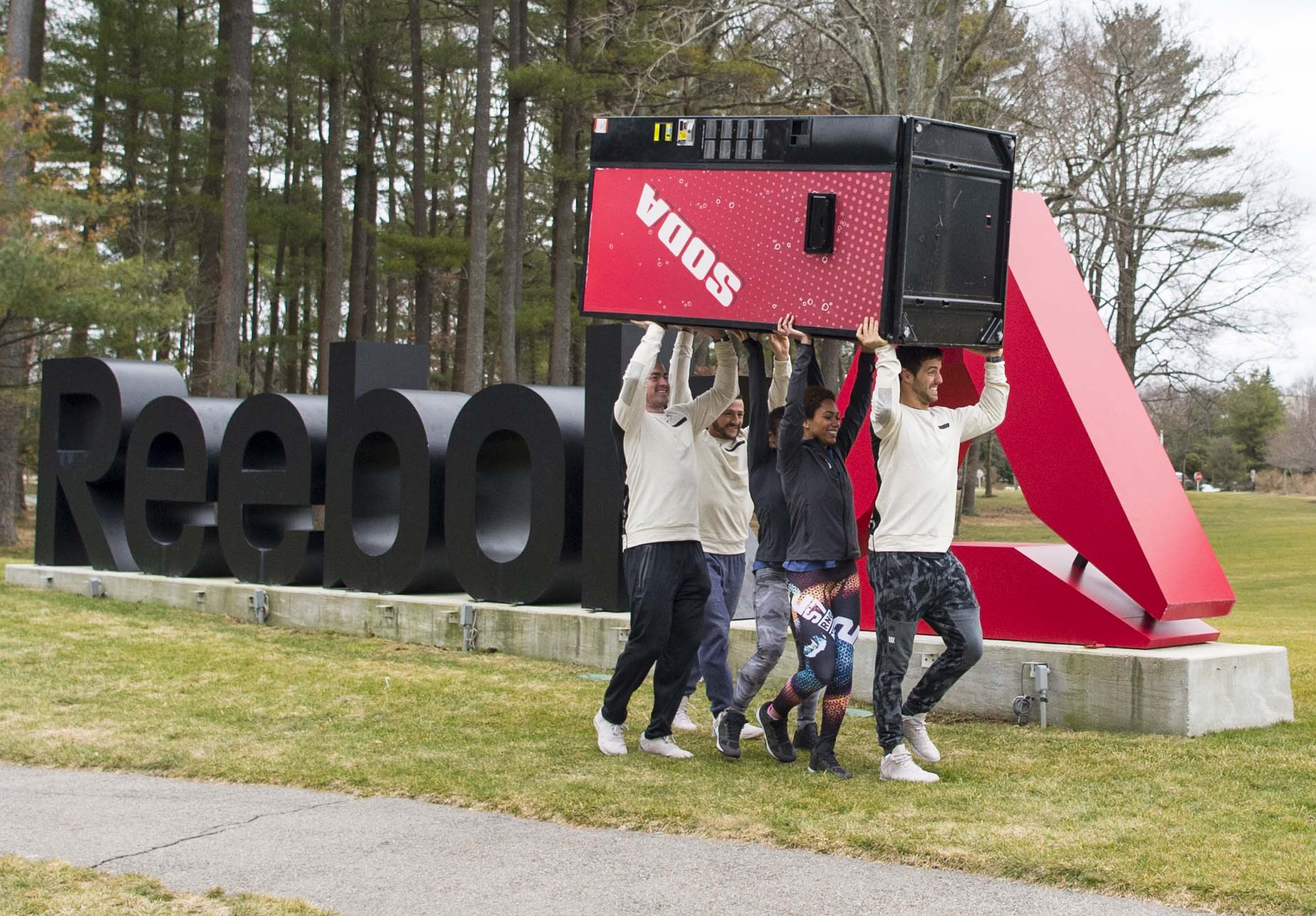 Reebok staff celebrate saying 'See Ya Soda,' at the fitness brand's global HQ in Canton, Mass on March 10.