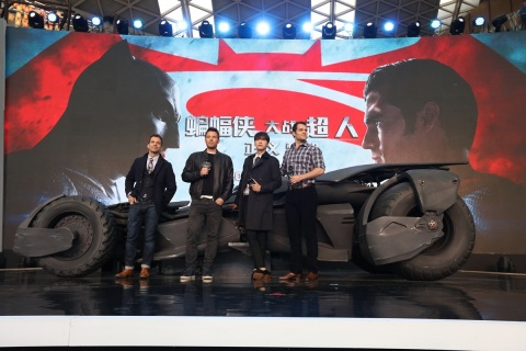Zack Snyder (far left), director of Warner Bros. Pictures' Batman v Superman: Dawn of Justice, unveils the sleek new Batmobile onstage with (left to right) Ben Affleck, Chinese Spectator Ambassador Li Yifeng, and Henry Cavill, at a fan engagement event at Indigo Mall in Beijing, China, on Saturday, March 12, 2016. (Photo: Business Wire)