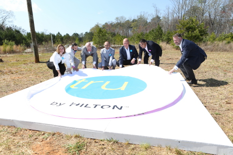 Tossing hard hats and shovels aside, Tru by Hilton celebrates the groundbreaking of its first property, in McDonough, GA. (Photo: Business Wire)