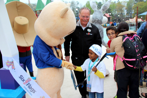 7-Year-Old Symeon from Make-A-Wish Georgia acts as Honorary Park President at Six Flags Over Georgia with Park President Dale Kaetzel. Symeon has been part of Make-A-Wish Georgia for two years and has recently been declared cancer-free. (Photo: Six Flags Over Georgia)