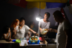 Panasonic's solar lanterns being used for income generation at night in the area devastated by super typhoon in Philippines (Photo: Panasonic Corporation)