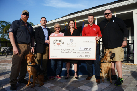 (From left to right) K9s Graduate Greg Wells and his service dog Utah, K9s For Warriors Executive Director Rory Diamond, K9s For Warriors Founder and President Shari Duval, BRAVE representative Robin Nicholson, Early Times Brand Manager Marc Hindorff, and K9s Graduate Joe Swoboda and his service dog Lilly. (Photo: Business Wire)