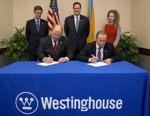 Westinghouse President and CEO Danny Roderick and Energoatom President Yuriy O. Nedashkovsky sign co ...