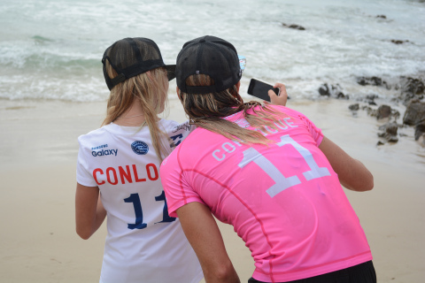 Courtney Conlogue, 2015 Samsung Galaxy Championship runner-up, takes a photo with a young fan sporting her jersey at the Roxy Pro Gold Coast in Australia (WSL/Jack Barripp)