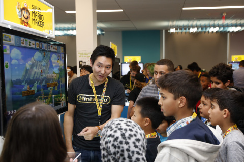 In this photo provided by Nintendo of America, Nintendo worked with the San Francisco Public Library to host an event on March 30 at The Mix space in SFPL's Main Library to teach San Francisco-based kids about the basics of video game level design using the Super Mario Maker game. Attendees were also able to play Super Mario Maker on the Wii U console with game experts from Nintendo who instructed kids how to design, play and share their own Super Mario Bros.-themed levels. (Alison Yin/AP Images for Nintendo of America)