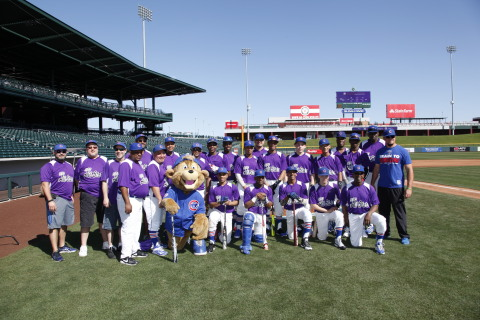 The Cubs RBI Junior All-Stars players and coaches huddle for a team photo before their game at Sloan ...