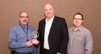 Teledyne LeCroy's Frank McCoubrey (center) presents the 2015 High Service Distributor of the Year Award to Digi-Key's Todd Jesme (left) and Cody Knutson (right). (Photo: Business Wire)