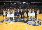 Harris Chairman, President and CEO Bill Brown (center left) and Orlando Magic CEO Alex Martins (center right) join the winning Apopka Police Department men's team and the second place Brevard County Sheriff's Office team during a halftime ceremony. (Photo: Business Wire)