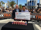 """Chula Vista Boys & Girls Club President and CEO Ken Blinsman accepts a $30,000 donation from """"Extra"""" host Mario Lopez in partnership with the Dairy Queen® system for the launch of the OREO S'mores and S'mores Blizzard® Treats. (Photo: Business Wire)"""
