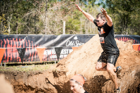 A Tough Mudder participant challenges the Old Spice Mud Mile 2.0 during the April 9, 2016 Tough Mudder event in Milton, Florida. (Photo: Business Wire)