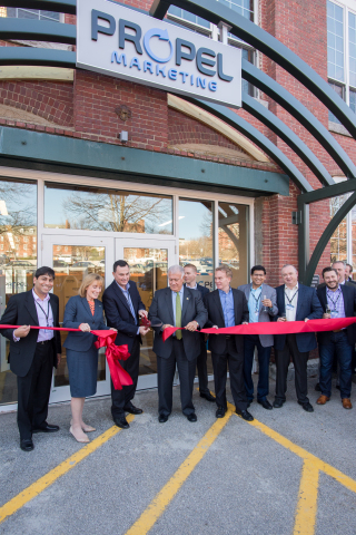 Propel Marketing CEO, Peter Cannone, cuts the ribbon to the new Manchester location alongside Governor Hassan and Mayor Gatsas. (Photo: Business Wire).