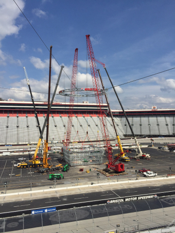 The build required a collection of cranes, often working in concert, to assemble and lift the system's massive support halo and screen frame. (Photo: Business Wire)