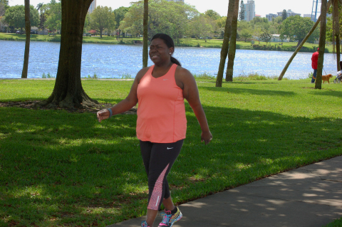 Vanessa Marrow, a personal health coach for Humana, takes a walk in a park as part of her healthy ro ...