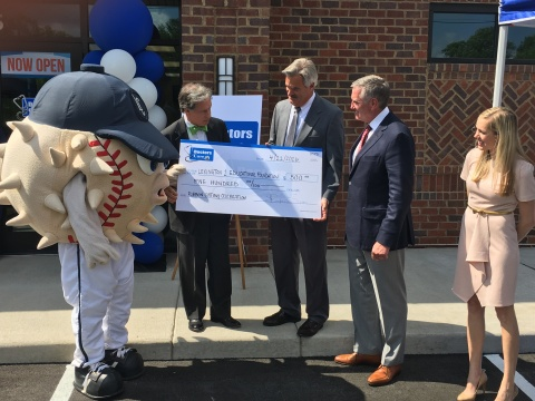 Check presentation (L-R): Blowie of Lexington County's Blowfish Baseball Club; David Boucher, president and COO of UCI Medical Affiliates; Mike Stacey, director of human resources for Lexington 1 School District; Dr. Thomas Gibbons, president and chief medical officer of Doctors Care, P.A. (Photo: Business Wire)